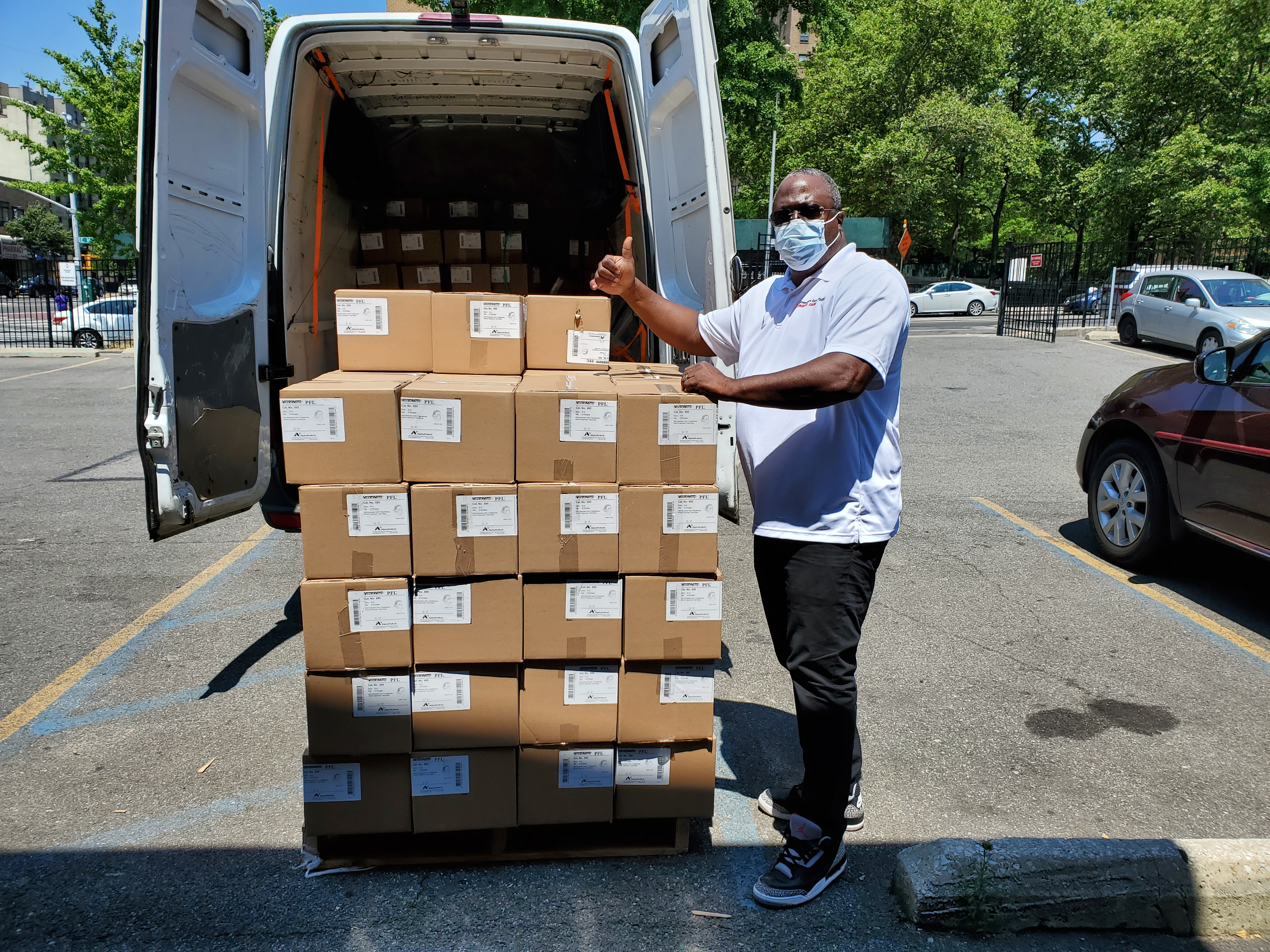 Man with boxes of masks